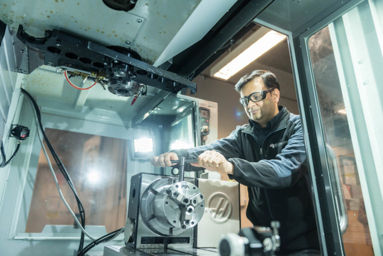 A researcher uses angle-resolved photoemission spectroscopy equipment in the Quantum Materials Lab at SBQMI.
